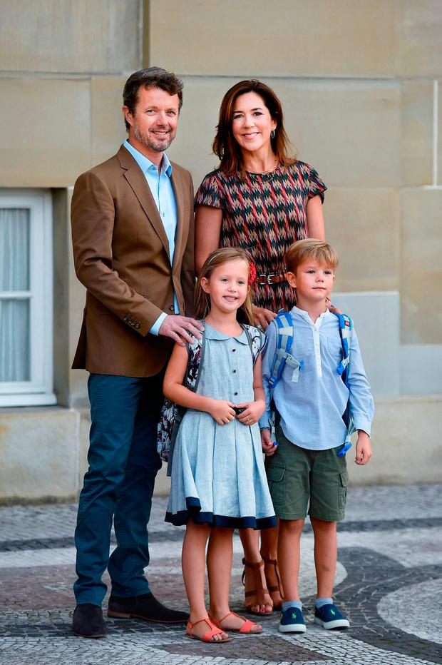 Danish Crown Prince Frederik and Crown Princess Mary pose with their twins Prince Vincent (R) and Princess Josephine (L) in front of Amalienborg Castle in Copenhagen on the sibling's first day of school on August 15, 2017.