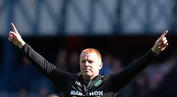 Hibernian manager Neil Lennon gestures to the Hibs fans at the final whistle during the Ladbrokes Scottish Premiership match between Rangers and Hibernian at Ibrox Stadium on August 12, 2017 in Glasgow, Scotland. (Photo by Mark Runnacles/Getty Images)
