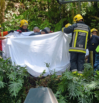A body is removed from the scene of the tragedy. Photo: ASPRESS via AP