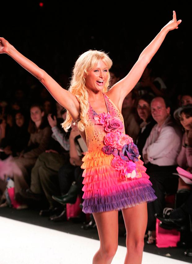 Socialite Paris Hilton poses at the Heatherette fashion show during 2004 Olympus Fashion Week on September 8, 2004 in New York City. (Photo by Evan Agostini/Getty Images)