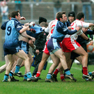 5 February 2006; Tyrone and Dublin players scuffle during the game as Dublin manager Paul Cafferey tries to intervene. Allianz National Football League, Division 1A, Round 1, Tyrone v Dublin, Healy Park, Omagh, Co. Tyrone. Picture credit: Oliver McVeigh / SPORTSFILE