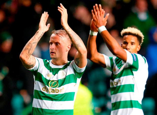 Celtic's Leigh Griffiths and Scott Sinclair applaud the fans. Photo: Jeff Holmes/PA Wire