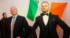 Conor McGregor's father Tony with the Conor McGregor waxwork of the MMA champion dressed in one of his trademark suits. Photo: Leah Farrell/RollingNews.ie