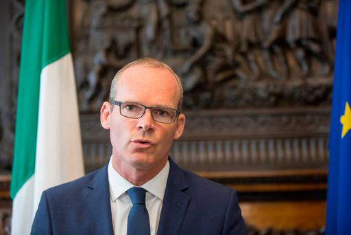 Minister Simon Coveney briefs the media in response to the UK position paper on Northern Ireland at Iveagh House yesterday. Photo: Mark Condren