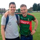 Young GAA player Joe Deacy with Mayo footballer Lee Keegan
