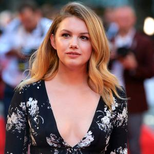 Hannah Murray poses for a photograph upon arrival at the European premiere of