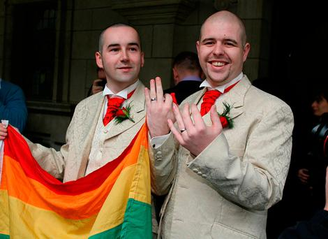 Henry Edmond Kane (left) and partner Christopher Patrick Flanagan outside Belfast City Hall after their civil partnership ceremony. Photo: Paul Faith/PA Wire