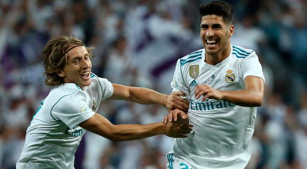 Real Madrid's Marco Asensio celebrates scoring their first goal with Luka Modric