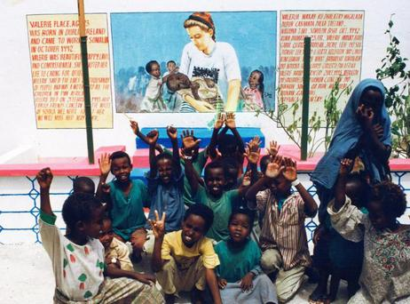 Children in Mogadishu sit underneath a mural of the late Valerie Place. Photo: Concern