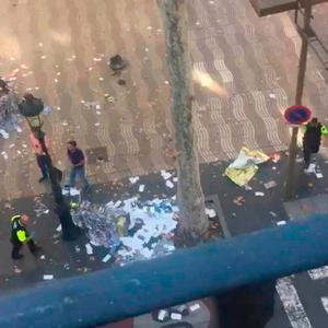 Screengrab taken with permission from video posted on twitter by @pawilerma of the scene in Las Ramblas, Barcelona after several people have been injured after a van crashed on a pavement in a popular tourist area of the Spanish city. Pawi Lerma/PA Wire