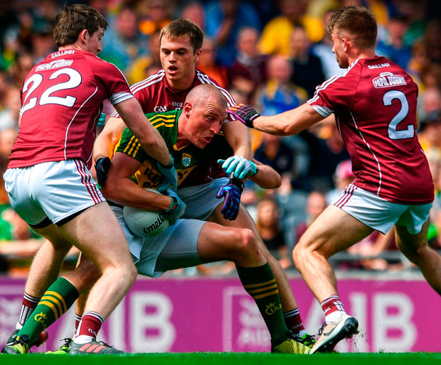 Kerry's Kieran Donaghy holds onto possession despite the efforts of the Galway defence during the All-Ireland SFC quarter-final at Croke Park. Photo: Sportsfile