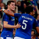 Everton's Michael Keane celebrates scoring their first goal with Ashley Williams