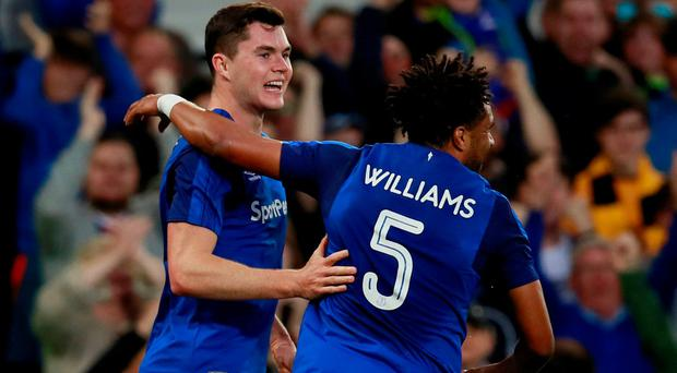 Everton's Michael Keane celebrates scoring against Split