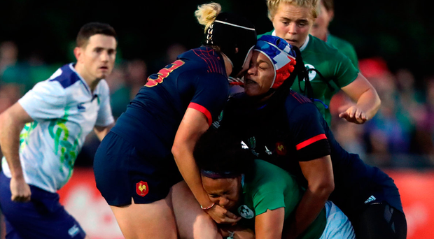 France's Safi N'Diaye and Celine Ferer clash heads as they tackle Ireland's Sophie Spence during last night's Women's Rugby World Cup, Pool C match. Photo: PA