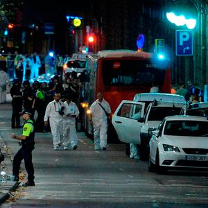 Forensic policemen arrive in the cordoned off area after a van ploughed into the crowd, killing 13 persons and injuring over 80 on the Rambla in Barcelona. Photo: AFP/Getty Images