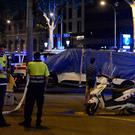 The van that ploughed into the crowd, killing at least 13 people and injuring around 100 others is towed away from the Rambla in Barcelona. Photo: AFP/Getty Images