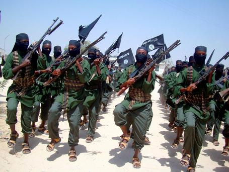 In this file photo, al-Shabab fighters march with their weapons during military exercises (AP Photo/Mohamed Sheikh Nor, File)