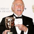 File photo dated 20/4/08 of Bruce Forsyth with the Bafta Fellowship award during the British Academy Television Awards at the London Palladium in central London, as the veteran entertainer has died aged 89. Photo: Yui Mok/PA Wireholder.