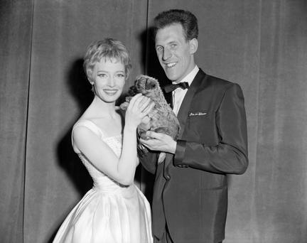 File photo dated 03/05/59 of film and TV star Jeannie Carson receiving a surprise gift, a Cairn terrier puppy, from host Sir Bruce Forsyth after the 'Sunday Night at the London Palladium' show, as the veteran entertainer has died aged 89. Photo : PA/PA Wire