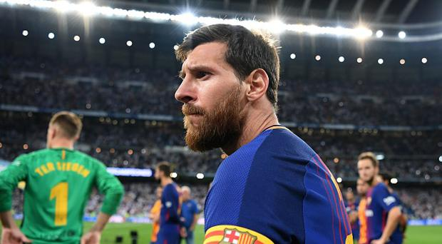 Barcelona's Argentinian forward Lionel Messi looks on after being defeated by Real Madrid at the end of the second leg of the Spanish Supercup football match Real Madrid vs FC Barcelona at the Santiago Bernabeu stadium in Madrid, on August 16, 2017. / AFP PHOTO / GABRIEL BOUYS (Photo credit should read GABRIEL BOUYS/AFP/Getty Images)