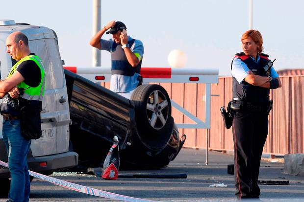 Police near a car involved in the terrorist attack in Cambrils. Photo: Getty Images