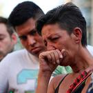 People react in the area where a van crashed into pedestrians at Las Ramblas in Barcelona on Thursday. Photo: Reuters
