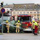Rescue personnel cordon off the place where several people were stabbed at Turku Market Square in Finland yesterday. Picture: Reuters