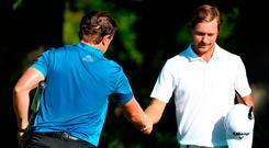 Paul Dunne of Ireland is is congratulated on his win by Jens Fahrbring of Sweden (R) Photo: Getty