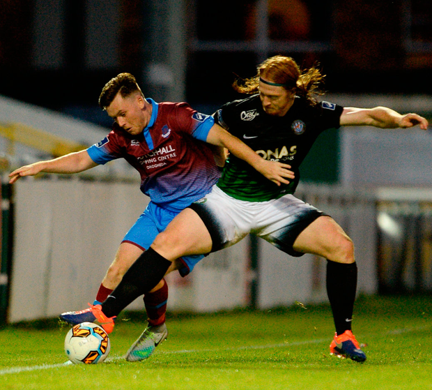 Sean Russell of Drogheda United tackles Hugh Douglas of Bray Wanderers Photo: Sportsfile