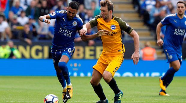 Leicester City's Riyad Mahrez in action with Brighton's Dale Stephens