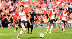 Southampton's Charlie Austin scores his side's third goal of the game from the penalty spot