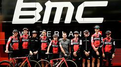Retired Australian cyclist, BMC's former rider, Cadel Evans (5thR) poses for photographers with riders of the USA's BMC Racing cycling team. JEFF PACHOUD/AFP/Getty Images)