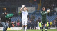 Chris Wood and Robert Green of Leeds United claps the fans after the Sky Bet Championship match between Leeds United and Sheffield Wednesday at Elland Road on February 25, 2017 in Leeds, England.(Photo by Nathan Stirk/Getty Images)