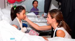 ROYAL VISIT: Queen Letizia of Spain consoles Irish girl Nailah Potot and her family at Hospital del Mar in Barcelona yesterday. Picture: AFP