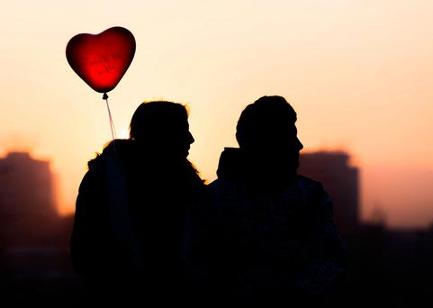 TRUE ROMANCE: Young love is a less personal process for today's teenagers. Below: Many find it easier to express their feelings through emojis and messages rather than face to face. Stock picture
