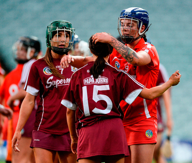 Aoife Donohue, right, and Heather Cooney of Galway are consoled by Ashling Thompson of Cork Photo: Sportsfile