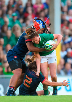 Nora Stapleton of Ireland is tackled by Safi N'Diaye and Gaelle Mignot of France during the 2017 Women's Rugby World Cup match. Photo: Matt Browne/Sportsfile