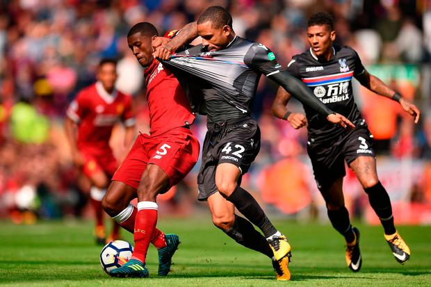 Liverpool's Dutch midfielder Georginio Wijnaldum (L) vies with Crystal Palace's English midfielder Jason Puncheon Photo: Getty