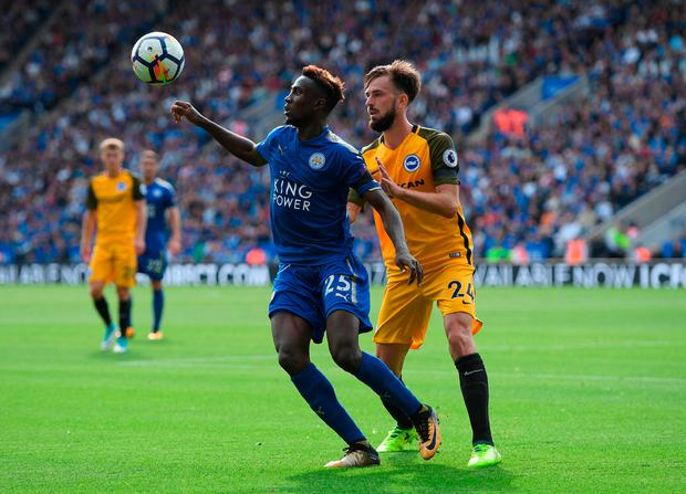 Wilfred Ndidi of Leicester City and Davy Propper of Brighton and Hove Albion battle for possession Photo: Getty