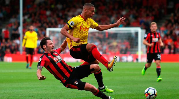 Adam Smith of AFC Bournemouth tackles Richarlison de Andrade of Watford Photo: Getty