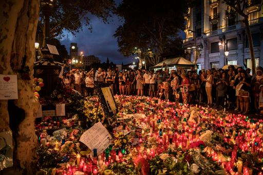 People gather at a memorial tribute of flowers, messages and candles to the victims on Barcelona's historic Las Ramblas, two days after the vehicle attacks. Photo: AP
