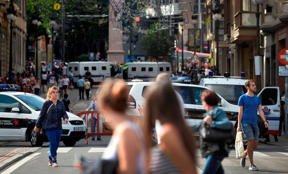 Police vans block the the street at the beginning of fiestas of Bilbao, after a van ran down pedestrians in Barcelona's Las Ramblas on Thursday. Photo: Reuters
