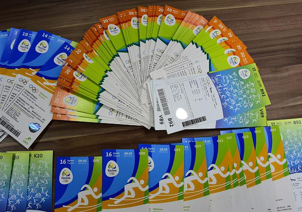 Tickets of the Rio 2016 Olympic Games seized to one of the directors of THG Sports, a company of international business events and information group Marcus Evans, Irish Kevin James Mallon, are displayed during a press conference at the City Police's station in Benfica, north of Rio de Janeiro, Brazil, on August 8, 2016. / AFP / TASSO MARCELO