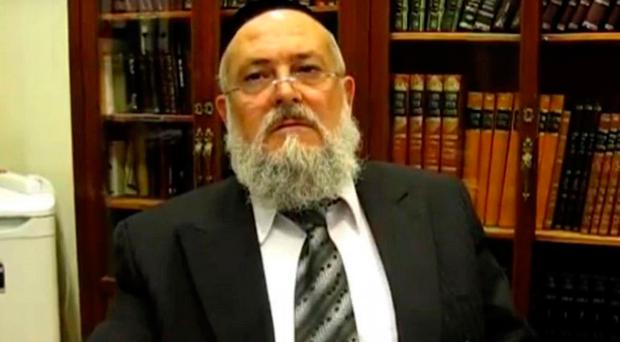 Barcelona's chief rabbi, Meir Bar-Hen, says he has been encouraging his congregation to buy property in Israel