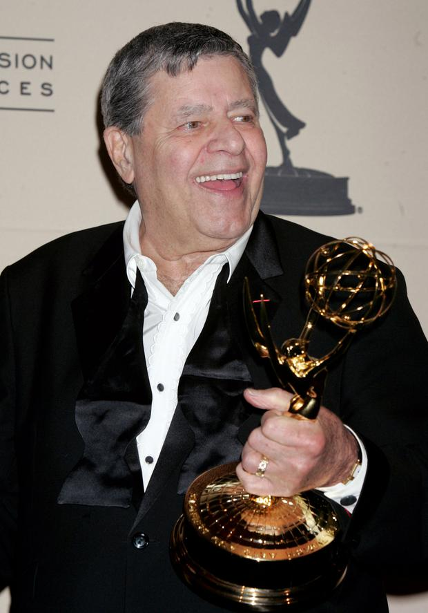 Comedian Jerry Lewis poses with the Academy of Television Arts & Sciences Governors Award he received at the 2005 Primetime Creative Arts Emmy Awards in Los Angeles, California, U.S. on September 11, 2005. REUTERS/Fred Prouser/File Photo