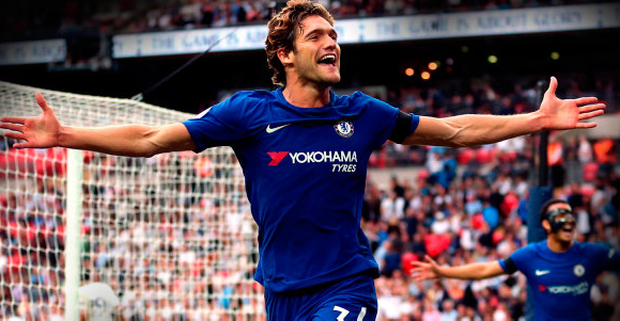 Chelsea wing-back Marcos Alonso celebrates his second goal that beat Spurs at Wembley yesterday
