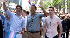 Canada's Prime Minister Justin Trudeau (L) walks with his Irish counterpart Taoiseach Leo Varadkar (C) and his partner Dr. Matthew Barrett during the Montreal Pride parade in Montreal, Canada August 20, 2017. REUTERS/Christinne Muschi