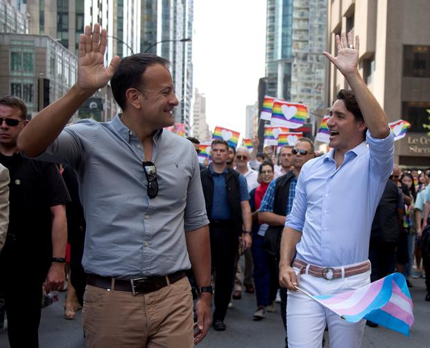 Canada's Prime Minister Justin Trudeau (R) walks with his Irish counterpart Taoiseach Leo Varadkar (L) during the Montreal Pride parade in Montreal, Canada August 20, 2017. REUTERS/Christinne Muschi