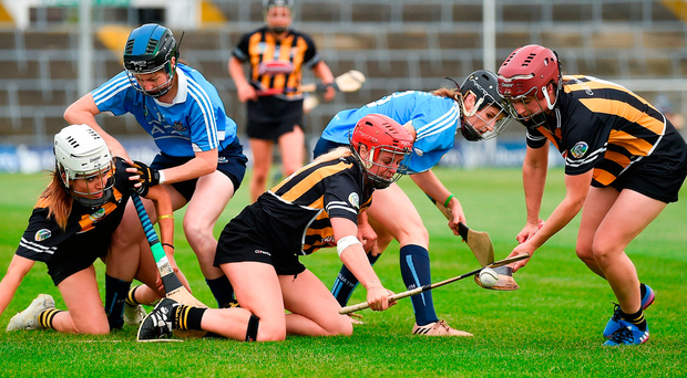 Anne Dalton (far right) comes away with the sliotar as Kilkenny and Dublin players battle for possession during their All-Ireland semi-final. Photo: Sportsfile