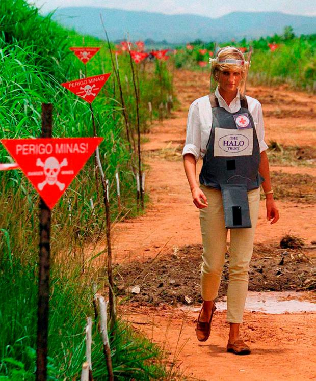 Diana touring a minefield in body armour during a visit to Angola in early 1997. Photo: John Stillwell/PA